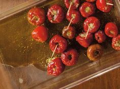 Briny capers, fatty tuna, and salty, pungent anchovies balance the heat in these small, stuffed cherry peppers.