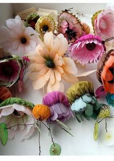 gorgeous intricate floral pieces, made from paper  and fabric by french artist lyndie dourthe