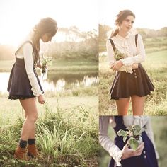 In a different era. Http://Www.Zlz.Com/ Navy Overall Skirt, Www.Sheinside.Com Camel Coloured Lace Up Boots, Op Shop Frilled Collared Top