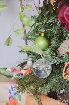 Tropical Bohemian Christmas Tree - Casa Watkins Living Tropical Christmas Trees, Bohemian Christmas, Clear Ornaments, Christmas Decorations, Table Decorations, House Styles, Plants, Plant Propagation, Diy