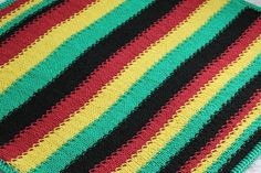 Hand Knit Cotton Rasta Baby Blanket...Instead I'll single or double crochet this afghan.