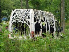 Forests Cut into Vehicles and Street Signage by Dan Rawlings | Colossal