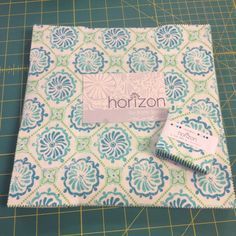 I am absolutely in love with this line of fabric by Kate Spain. I'm making a mini and a big quilt out of it!