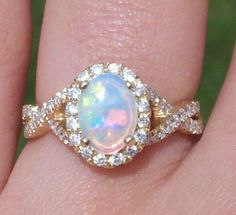 Opal engagement ring. My mother loved opals and it was her birthstone wouldn't mind an engagement ring to honor her