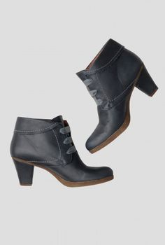 Ribbon Boot   Pretty boots in the softest leather, wrapped up with a ribbon lace. With a square, mid-rise heel, contrast stitch detail and turn down tops. Very vintage and versatile, you won't want to take them off.