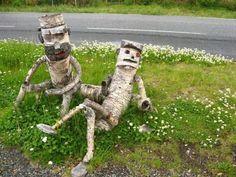 Birch bark buddies resting on the grass #gardenart #recycled #funny