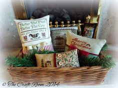 basket of cross stitched pin pillow ornaments