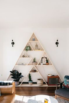 Geometric triangle bookshelf. at home with: sophie carpenter.
