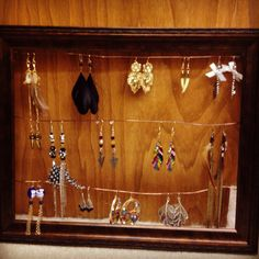 Earring organizer. All you need is a picture frame, craft wire ($1 at Wal Mart) and hot glue!