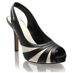 white and black sling back heels