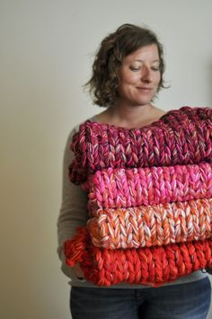 I love this blanket idea. Multiple strands knitted into a blanket on large needles. This would knit up quickly and be very warm!