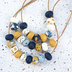 Ochre, navy and white, love this colour combination. Handcrafted necklaces can be found on Etsy @rubybluejewels