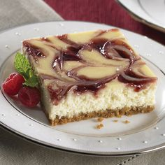 You don't need a springform pan to prepare this cheesecake recipe. Instead you bake it in a 13x9-inch pan and cut it into bars. The bars are made extra-special with raspberry preserves marbled throughout the filling.