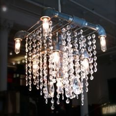 """See if I can get this DIYed...    $1,435  Dark gray steel pipes. Optically pure leaded crystal. Hangs from a thin, adjustable galvanized steel cable. 9 sockets. Can be hung from junction box or on a hook and plugged into a wall. Adjustable 5' black steel cable. 15-watt bulbs can be swapped out for 25-watt bulbs. Instructions included. Dimensions with crystals: H 15"""" W 11"""" D 9""""."""