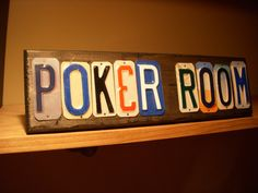 POKER ROOM sign made with recycled license plates.