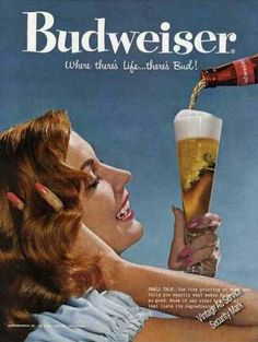 The book takes place in the 50's. This print Budweiser ad would be hanging in a liquor store around that time