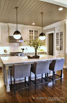Here's a nice example of a simple way to decorate a kitchen island with your home is for sale! #homestaging #homesellingtips