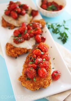 Crispy Parmesan Chicken with Balsamic Roasted Tomatoes http://www.thecomfortofcooking.com/2013/12/crispy-parmesan-chicken-with-balsamic-roasted-tomatoes.html
