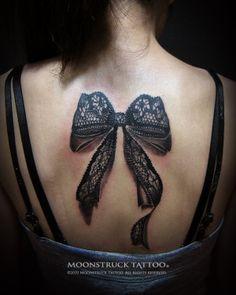 Black lace bow tattoo