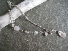 Silver necklace with Rock crystal and Rose quartz, silverbeads and a pendant made of PMC silverclay.