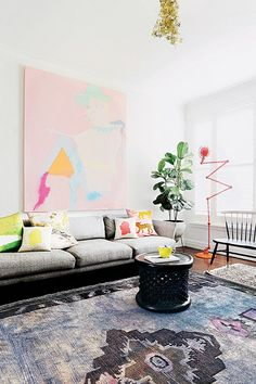Light airy room with colorful pastel art and moody rug