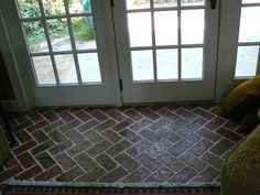 The Wright's Ferry brick tiles are made in the Marietta color mix, but fired to a darker brown background tone. The floor was then sealed with a shiny sealer.