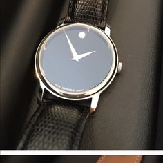 Movado woman's watch Very classy designer watch. Leather strap slim and in great condition. This watch was worn twice. Movado Other