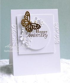 hand crafted anniversary card ... lovely white on white texture and punched flowers ... single die cut butterfly .... great layout design ...