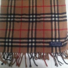 Authentic Burberrys of London scarf Small holes in 2nd pic and 4th pic. Gently used Burberry Accessories Scarves & Wraps