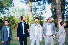 Dapper groom + groomsmen in mismatched blue & grey suits