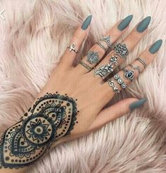 Gorgeous grey polish, silver rings and mendhi style tattoo (?)