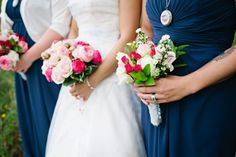 Pink bouquets with navy bridesmaids dresses.  Wedding planning & coordination by www.CustomWeddingsofColorado.com