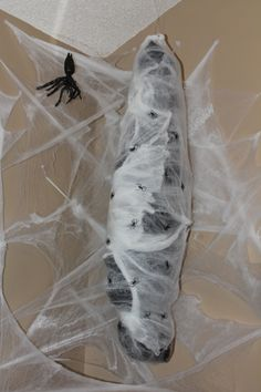A large trash bag, newpaper and string. Then I wrapped it in spider webbing and fishing line to hang it.