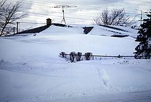 A house almost completely buried in snow in Tonawanda, New York (January 30, 1977)
