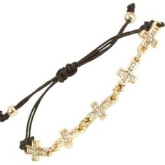 """Heirloom Finds Trendy Gold Tone Crystal Tiny Sideways Cross Black Macrame Bracelet Heirloom Finds. $8.99. Trendy sideways cross bracelet. Great worn alone or layered with other bracelets for added style!. Bracelet can be adjusted from 4"""" to 8"""". Makes a Great Gift. Arrives Gift Boxed!. A popular style among celebrities!. Save 64% Off!"""