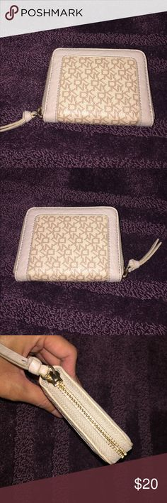womens dkny wallet womens DKNY wallet. 6 card slots with a compartment for coins. its in a cream color and overall good condition. i didnt get much use out of it. any questions please ask. DKNY Bags Wallets