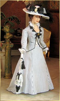 I was SOOO born in the wrong century. 1895. Spring ensemble made of striped cotton with lace and black details.