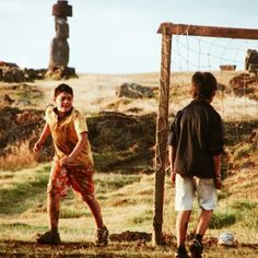 Kids play football in the afternoon, Easter Island, Chile.