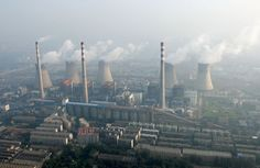 An aerial view shows a coal-burning power plant on the outskirts of Zhengzhou…