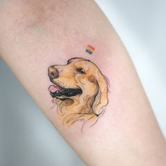 Sketchy labrador head tattoo on the left inner forearm.