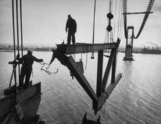 Bridgemen  Workers raise a truss 160 feet above the water during the construction of the Delaware Memorial Bridge in 1951.