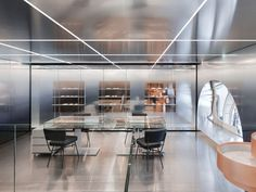 OMA organizes flagship repossi store in paris as three distinct spaces