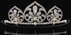 PROPERTY OF AN AUSTRIAN NOBLE FAMILY  Diamond tiara/necklace, circa 1910  The graduated open work spade-shaped motifs set with cushion-shaped, circular-, single-cut and rose diamonds, set along a row of similarly cut stones, spade motifs and line of diamonds detachable, accompanied by additional fittings including original screw driver, fitted case stamped F. Kandelhart, Juwelier, Wien VII, Zollergasse 35.  Image and description Sotheby's