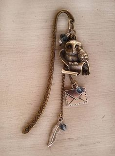 Owl Post Bookmark by jennieingram. I don't like metal bookmarks, but I think this one is a magical gift.