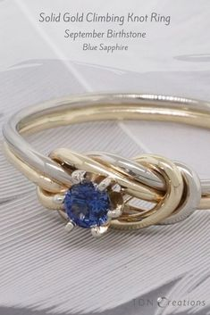 This September, let your birthstone, blue sapphire, tell your story. This elegant solid gold climbing knot September ring is the best alternative engagement ring you can give her on her birth month.