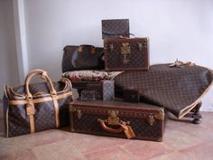 i want this collection of LV luggage & someone to carry it all for me too Cause those suckers don't have casters on them!