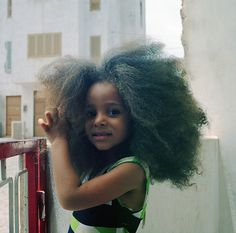 little girl. big hair.