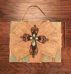 A personal favorite from my Etsy shop https://www.etsy.com/listing/449134822/teal-burlap-wood-sign-with-cross-7-14-x