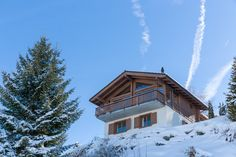 """Lovely chalet """"Lonestar"""" located close to the slopes in Nendaz in Switzerland. It enjoys a breathtaking view of the Swiss Alps. Look up more info by clicking the button ! Swiss Chalet, Swiss Alps, Large Windows, Stunning View, Ground Floor, Nice View, Switzerland, The Neighbourhood, Restoration"""