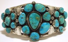 Old Pawn Sterling Silver Cuff Bracelet set with clusters of Morenci Turquoise. By Navajo artist, Mary Morgan.